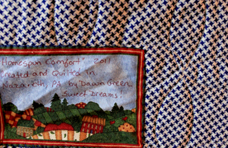 Back of homespun comfort quilt with label